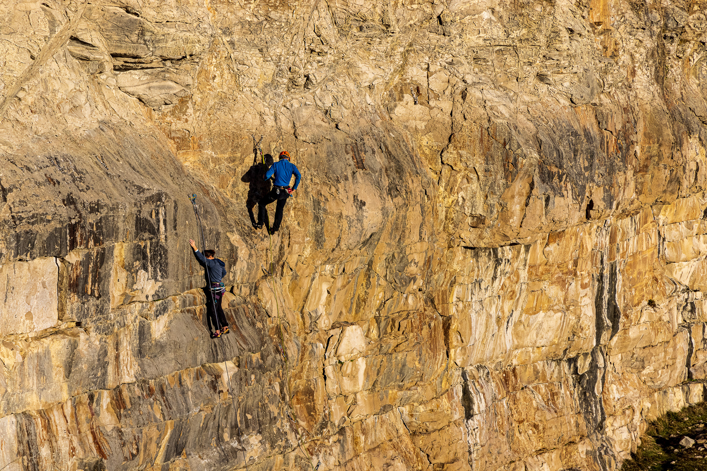 Rock climbers on the cliffs at Dancing Ledge, Purbeck