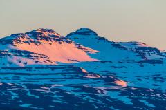 Alpenglow on the mountains behind Djupivogur