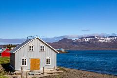 Building on the edge of the harbour at Neskaupstaður, Eastfjords, Iceland