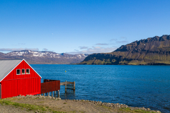 Red-painted building on the shore at Neskaupstaður