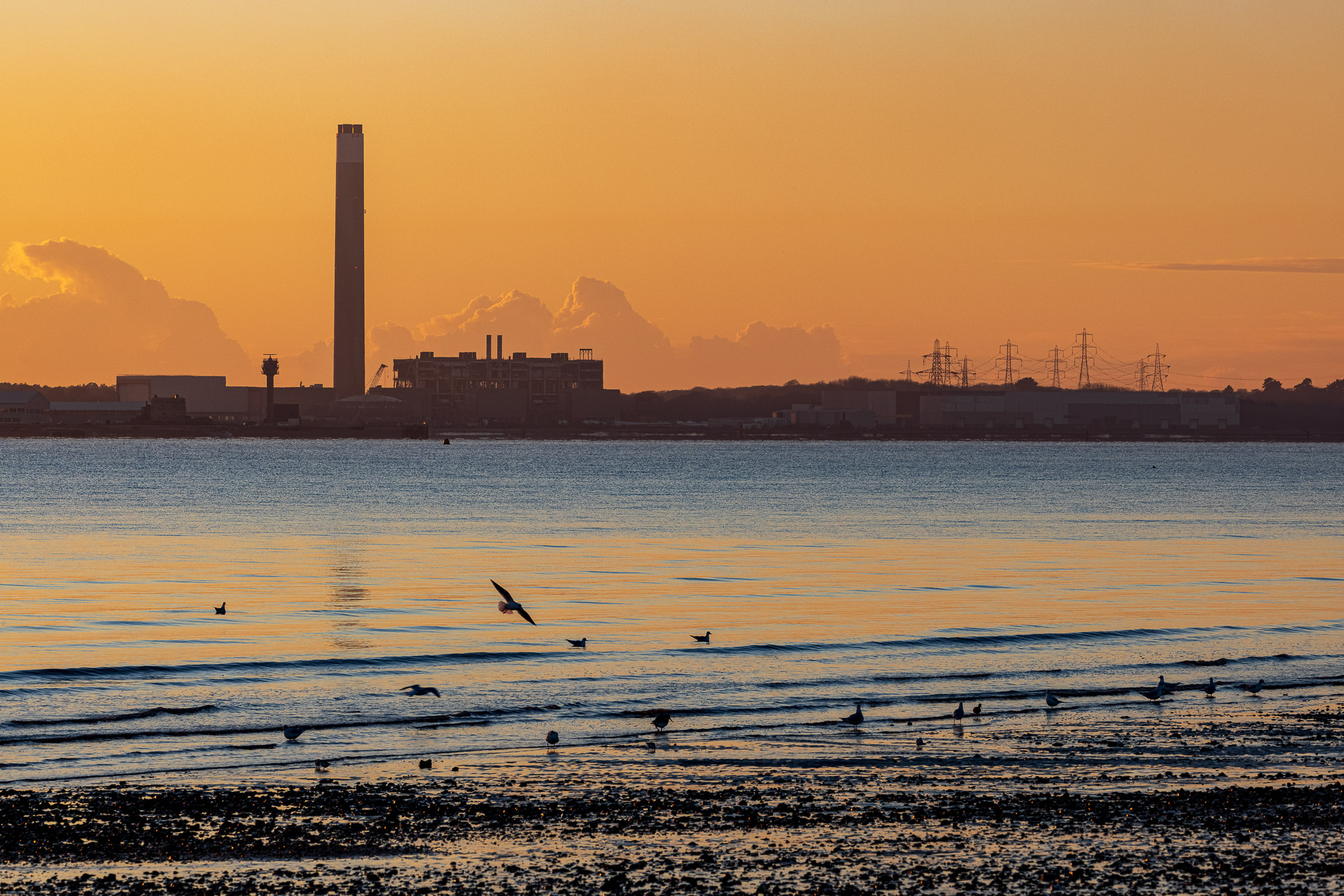 Sunset behind the Fawley Power Station