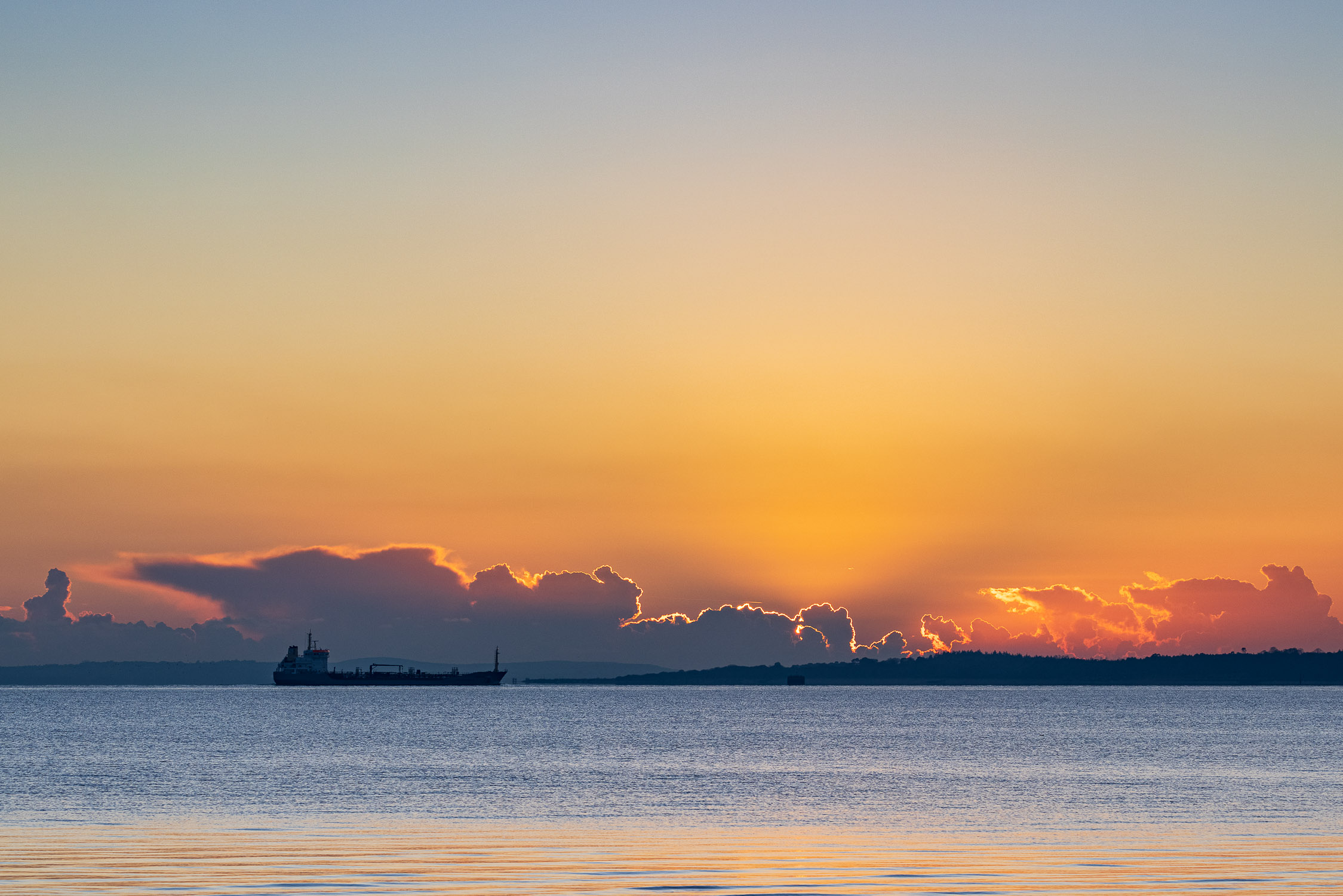 Sunset and oil tanker