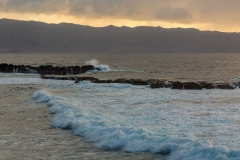 Waves roll in to Shark's Cove on Oahu's North Shore, bathed in e