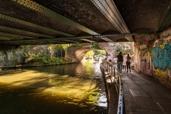 The Regents Canal towpath passes under a series of bridges as it