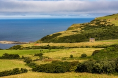 Low Peak farmhouse and the coast at Ravenscar